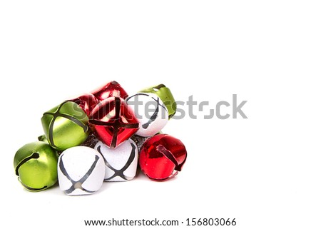 Christmas jingle bells on a white background - stock photo