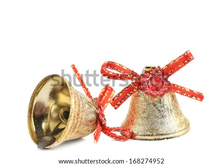 Christmas jingle bells with red ribbon. Isolated on a white background. - stock photo