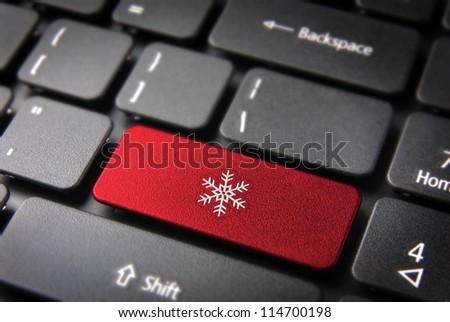 Christmas key with snowflake icon on laptop keyboard. Included clipping path, so you can easily edit it.