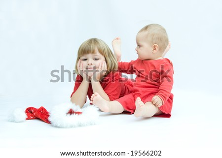 Christmas kids in Santa hat on white background - stock photo