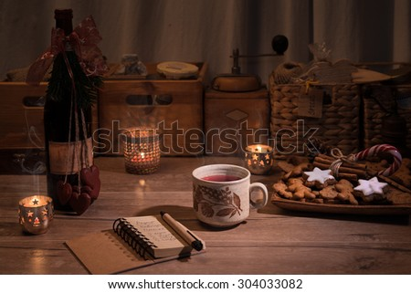 Christmas kitchen with mulled wine and cookies on the table - stock photo