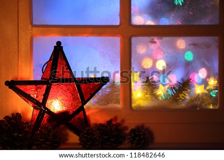 Christmas lantern and window,Closeup. - stock photo