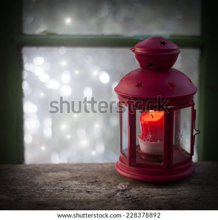 Christmas lantern in window - stock photo
