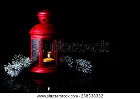 Christmas lantern on  a black background. / Christmas red lantern