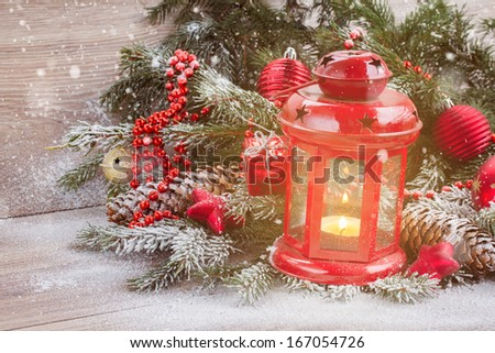 christmas lantern with evergreen tree and snow