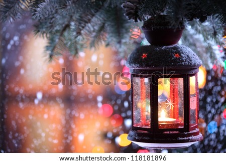 Christmas lantern with snowfall,Closeup. - stock photo