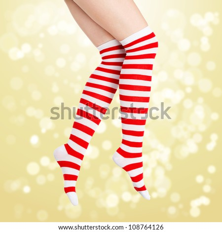 Christmas legs on gold background with blurred lights - stock photo