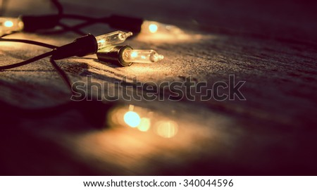 christmas light decor on wood background , color filter vintage tone
