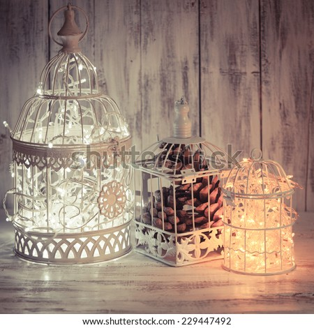 Christmas light decoration in a white bird cage. - stock photo