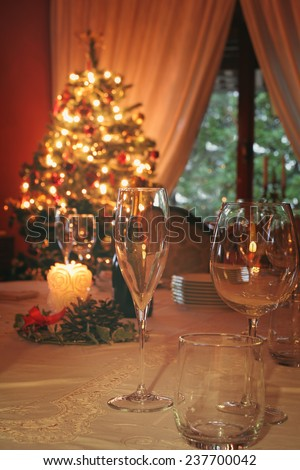 Christmas lights and decoration in the dining room . Celebration and toast