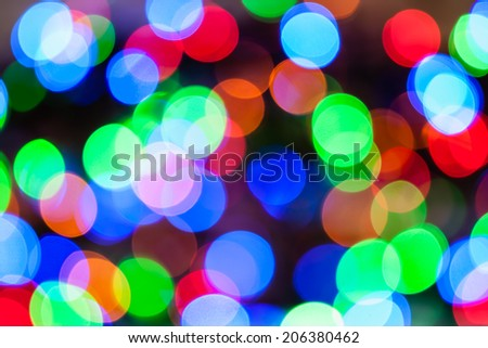 Christmas Lights Color Bokeh - A bright multicolor bokeh background created by a set of defocused Christmas lights. - stock photo