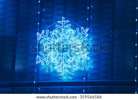 Christmas lights decoration on a building facade in blue tone. Horizontal - stock photo