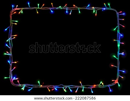 Christmas lights frame on black background with copy space.Decorative garland - stock photo