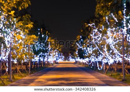 Christmas lights hanging on the tree - Celebration concept. - stock photo