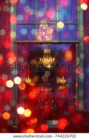 Christmas lights. Lights and Christmas decoration in the city in Winter. Colorful abstract background for Christmas.