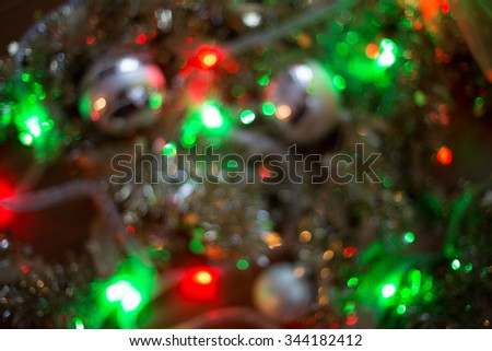 Christmas lights on a beautiful garland. Blurred.