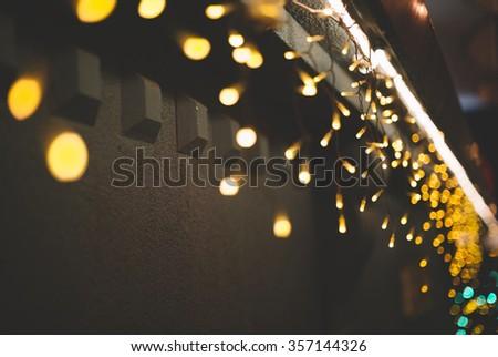 Christmas lights on the wall, selective focus - stock photo