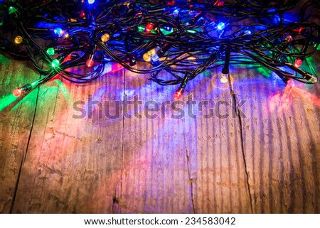 Christmas lights on wooden background, abstract template - stock photo