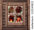 Christmas  lights seen through a wooden cabin window - stock photo
