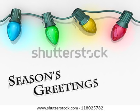 Christmas lights strong along the top of the image with the text Season's Greetings below. - stock photo