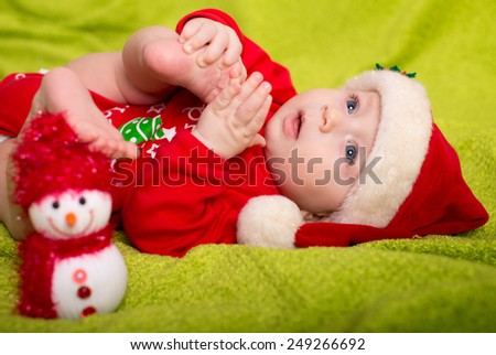Christmas little baby boy with Santa hat - stock photo