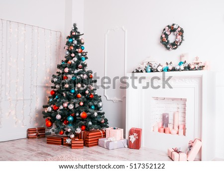 Christmas living room with decorated Christmas tree, gifts and fireplace. The idea for postcards.