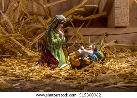 Christmas Manger scene with figurines including Jesus and Mary. Focus on Mary!