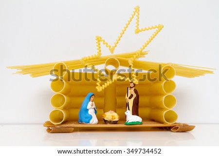 Christmas Manger scene with figurines including Jesus, Mary, Joseph, sheep made by pasta - stock photo