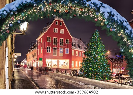Christmas market by night in a German town - stock photo