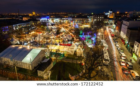 Christmas market in Galway at night, panoramic view from high point. - stock photo
