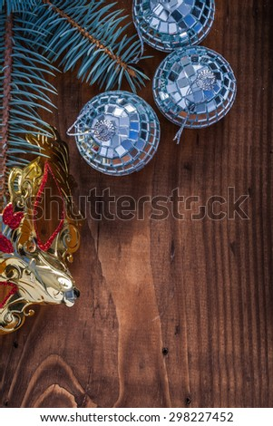 christmas mask baubles branch of fir tree on vintage wood board. - stock photo