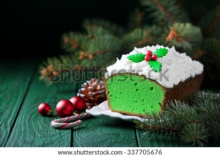 Christmas Matcha green tea cake with cream cheese frosting, selective focus - stock photo