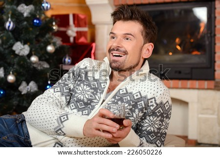 Christmas men. Happy Smiling men at home celebrating. New Year People - stock photo