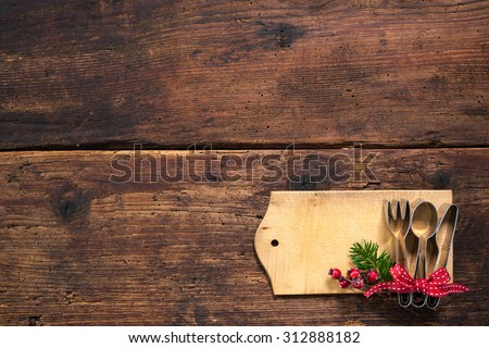 Christmas menu card for restaurants on wooden background - stock photo