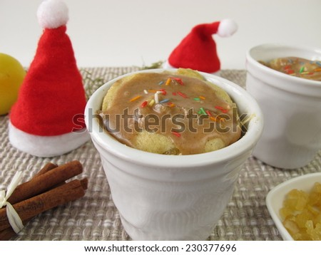 Christmas mug cake from microwave with succade and cinnamon icing - stock photo