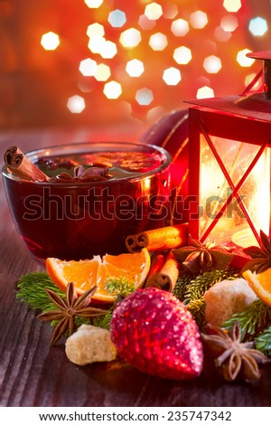 Christmas mulled wine with spices and orange. Selective focus. - stock photo