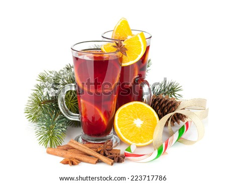 Christmas mulled wine with spices and snowy fir tree. Isolated on white background - stock photo
