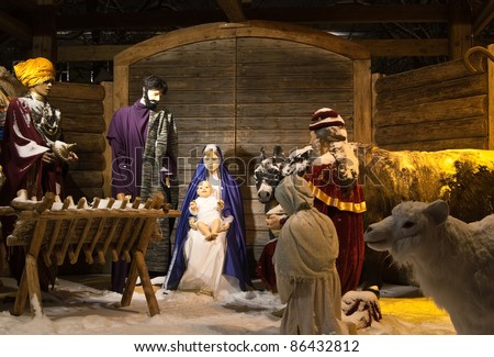 Christmas nativity figurines of Mary, Joseph, and Baby Jesus with the Wise Men and animals - stock photo