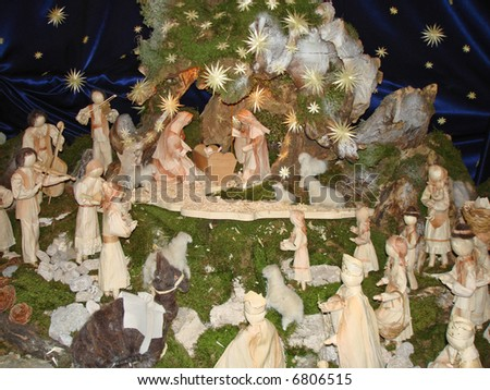 Christmas nativity scene made of natural materials such as moss, wood and corn husk - stock photo