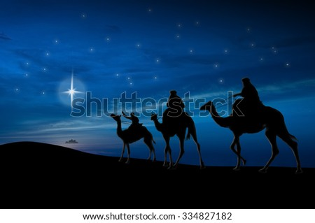 Christmas nativity scene of three wise men looking for baby Jesus - stock photo