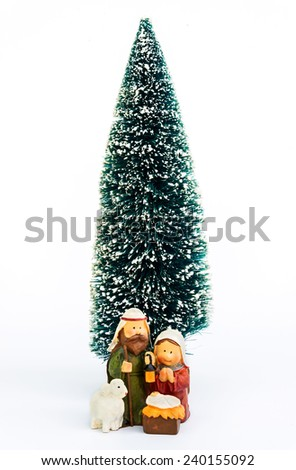 Christmas nativity scene with Mary, Joseph, and sheep looking down on baby Jesus in his manger  - stock photo