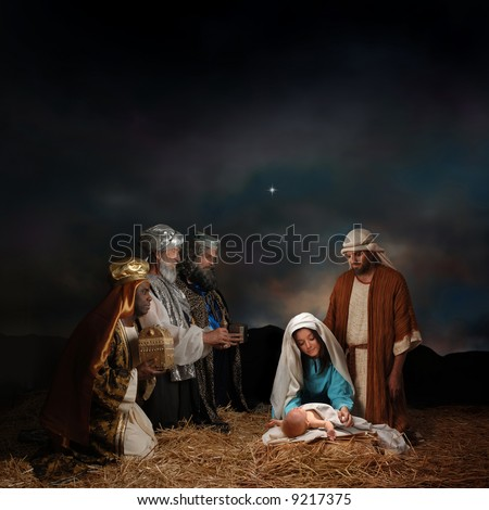 Christmas nativity scene with three Wise Men presenting gifts to baby Jesus, Mary & Joseph - stock photo