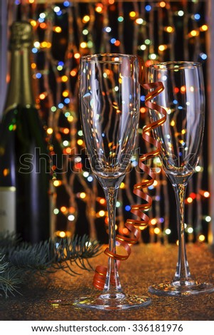 Christmas. New Year. Empty glasses of champagne and a glass bottle of Champagne. Boke. Blur. Celebration. Background.