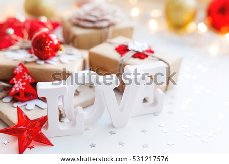 Christmas, New Year or Valentine's Day background with presents and decorations. Holiday background with stars confetti and light bulbs. Place for text.