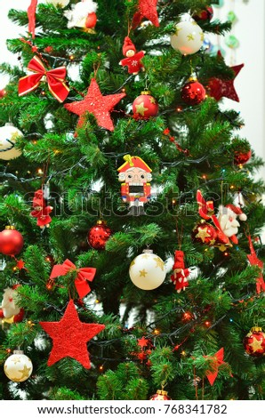 christmas (new year tree) eve and toy of nutcracker with garlands and lights and other decorations