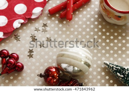 Christmas objects scattered on a polka dot background with room for copy