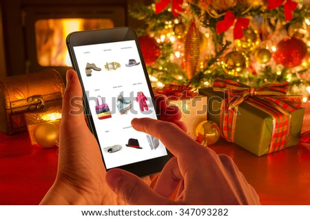 Christmas online shopping with phone. Christmas tree, gifts, lights and decorations.