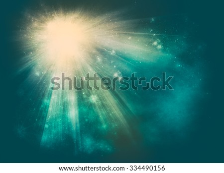Christmas or celebration background with an explosion of light and scattering of twinkling stars amongst the rays over a texture blue green background with copy space for your seasonal greeting - stock photo