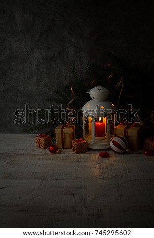Christmas or New Year background:Candle Lantern, glass balls, decoration and gifts on white wooden background