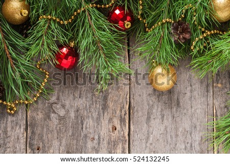 christmas or new year background pine branch with cones red and gold balls on